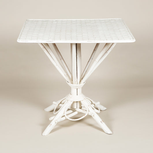 A square white-painted cane table. French, 20th century.