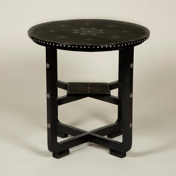 A late 19th century Anglo-Indian round ebonised table with inlaid mother-of-pearl decoration. Circa 1900.