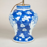 A mid-19th century Chinese baluster-shaped vase decorated with cherry blossom. Wired as a lamp. An associated hand painted shade is available.