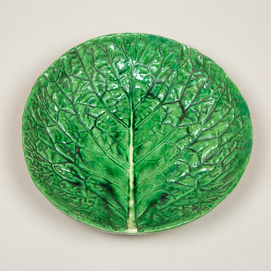 A large green glazed plate in the form of a cabbage leaf. French 20th century.