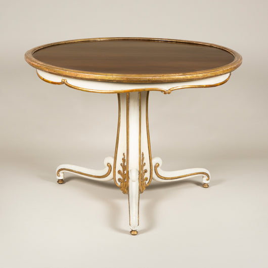 A William IV gilt and white table with an inset rosewood top on an elegantly carved tripod base, circa 1835.