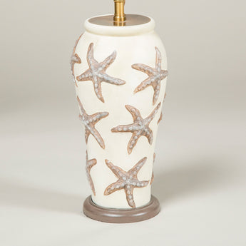 A 20th century French pottery vase with raised starfish decoration, wired as a lamp.