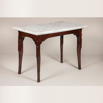An 18th century French oak console table with unusual stepped pied de biche legs and original marble top.