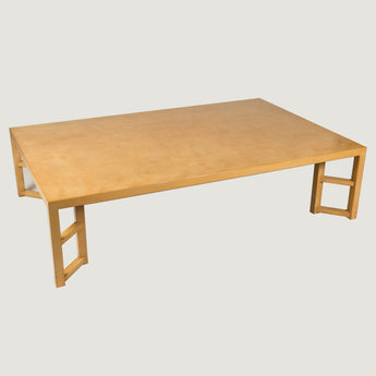 A large rectangular coffee table in a camel coloured lacquer with diagonally set supports. Price for this specification - £3,800.00 + vat.