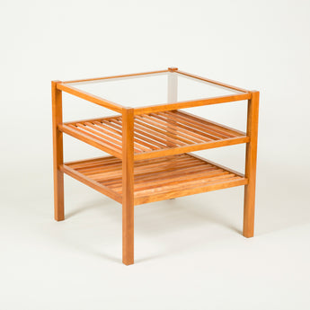 A pair of three-tier slatted cherrywood tables, late 20th century.