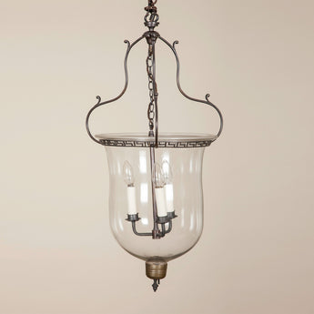 A 19th century glass hanging lantern with elegant Greek key pattern bronzed metal ring frame.