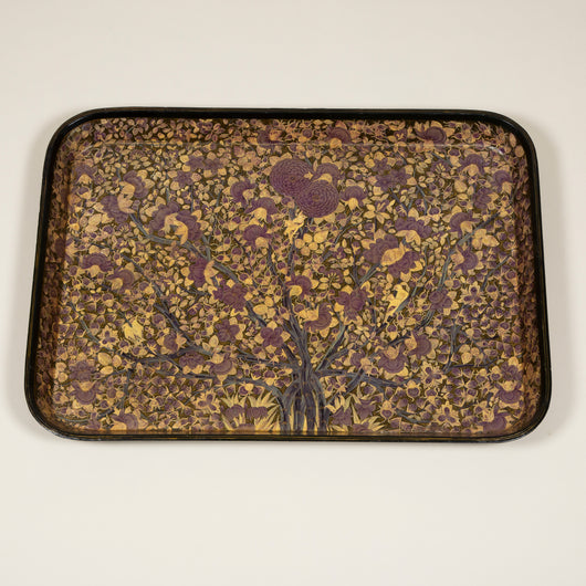 A large early 19th century rectangular papier mache tray with rounded corners and unusual all-over dense floral decoration, possibly redecorated in the later 19th century.