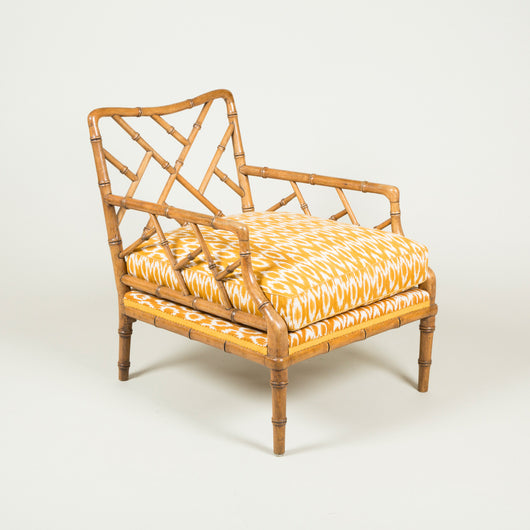 A 1960's faux bamboo cockpen armchair with a deep upholstered seat.