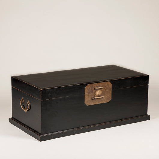 A large Chinese black-lacquered elmwood trunk, early to mid 20th century.