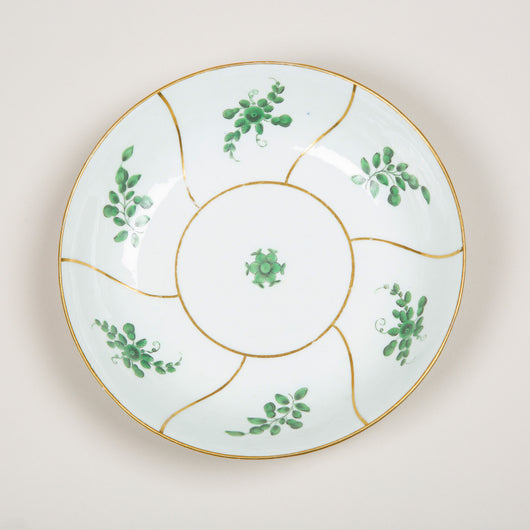 A late 18th century porcelain dish with hand painted green floral sprigs and gold line detail.