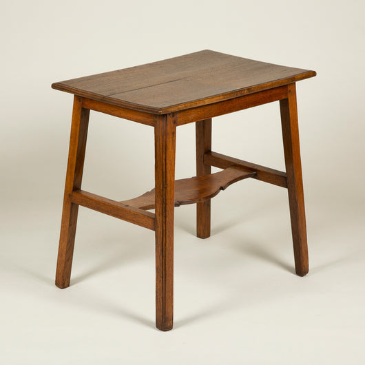 A rectangular oak table with splayed legs joined by an unusual flat shaped stretcher, Arts & Crafts, circa 1890.