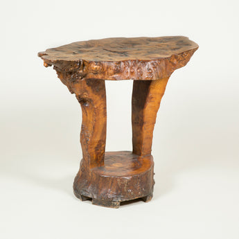 A rustic table cut from one piece of a burr-wood tree trunk. 20th century.