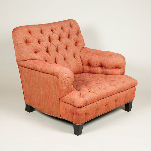 An unusually wide easy armchair with a square back and deep-buttoned upholstery. 20th century.