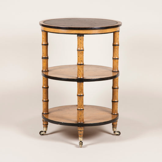 A Regency faux bamboo painted dumb waiter with three tiers, circa 1820.