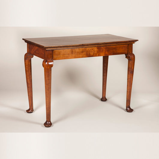 A pair of Italian walnut console tables of simple robust form, with rectangular tops and cabriole legs. Late 18th or early 19th century.