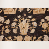 A Bessarabian kilim with stylized floral design in off-whites on a black ground. Eastern European, circa 1900.