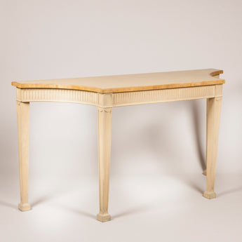 An Adam style painted side table with fluted frieze and square tapred legs from the Royal Box, Ascot. Mid 20th century.