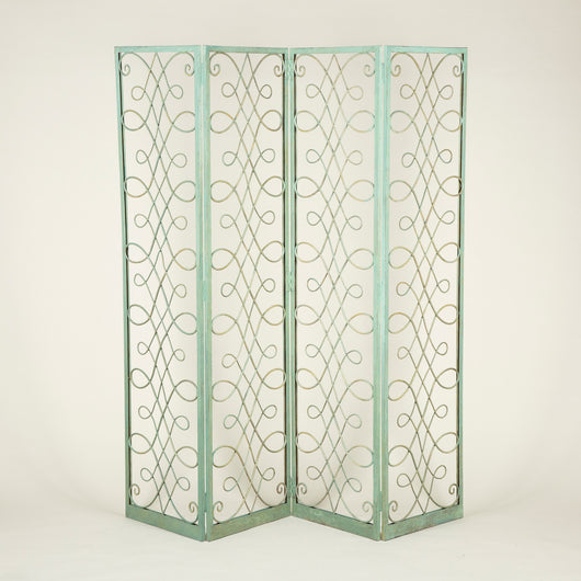 A painted wrought iron four-fold screen or room divider, attributed to Jules Leleu, France, circa 1930. Original colours and paintwork touched-in and refreshed where necessary.