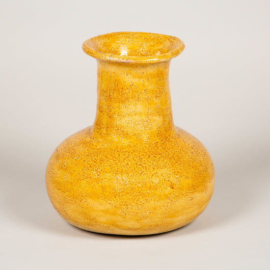 A yellow-glazed Accolay pottery pot-bellied vase. French, mid-20th century.
