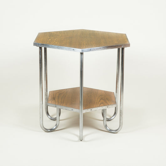 A tubular steel-framed and oak hexagonal two-tier table. Paris, early to mid 20th century.