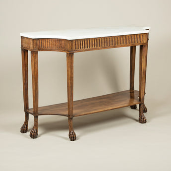 A pair of very attractive Italian fruitwood side tables, circa 1800, with white marble tops, incurved front corners, fluted frieze and square section fluted legs with a lower tier over claw feet.