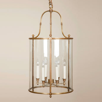 A large French gilt brass cylindrical hanging lantern in a simplifed Louis XVI style, mid-20th century.