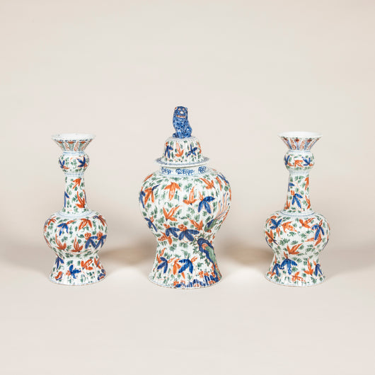 A late 18th or early 19th century Dutch Delft ribbed three piece garniture with polychrome decoration.