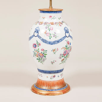 A late 18th century Chinese Famille Rose baluster vase decorated with flowers and swags, wired as a lamp.