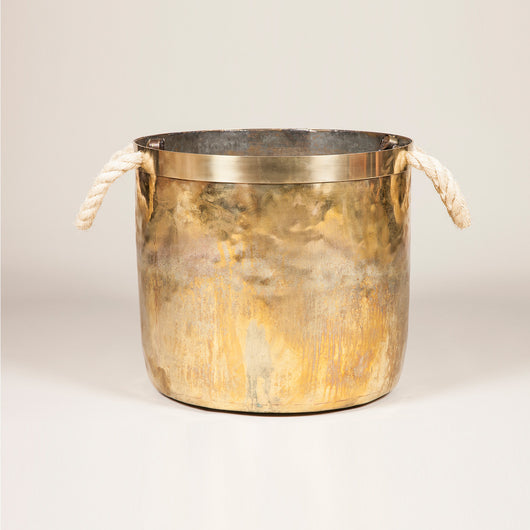 A large brass log bin, early 20th century, with new rope handles