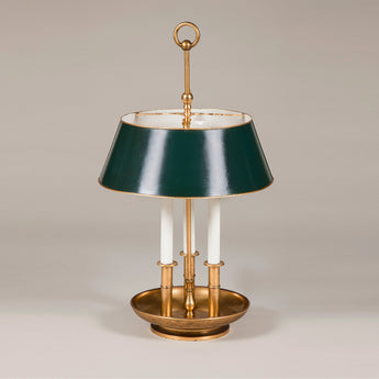 A brass bouillotte lamp with three candles and green tole shade. French, 1940's.