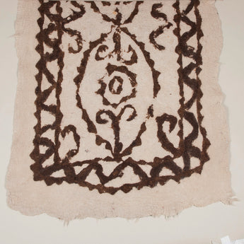 A 19th century or early 20th century Turkish felted wool rug with a dark brown scroll design on a cream ground.