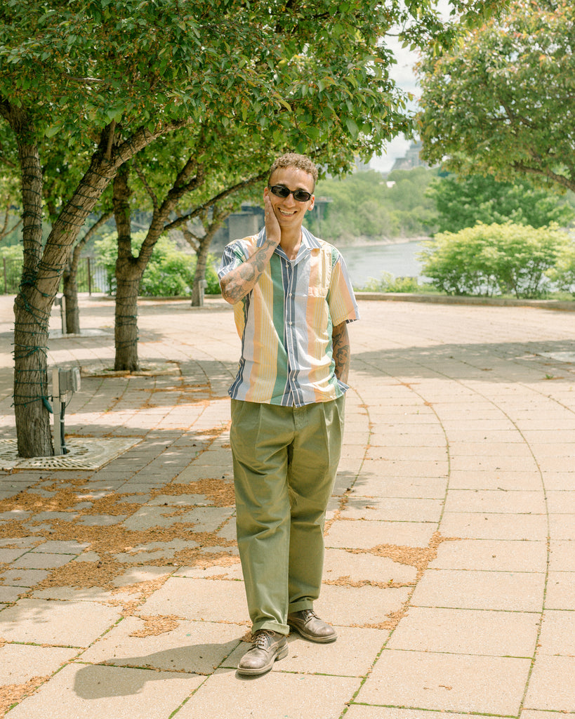 Man standing on street wearing Gitman Vintage shirt and Stan Ray chinos