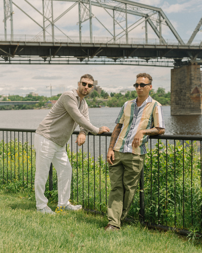 Two men next to a river wearing Gitman Vintage and Stan Ray