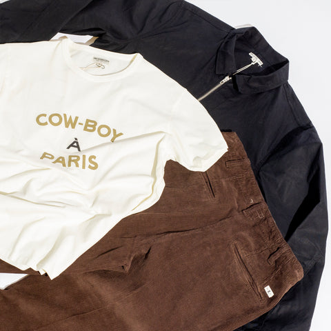 Knickerbocker cowboy tshirt, jacket and trousers piled up