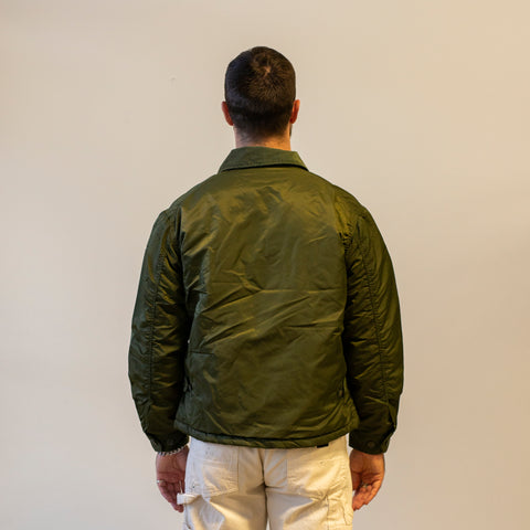 Model wearing Engineered Garments Driver Jacket Olive