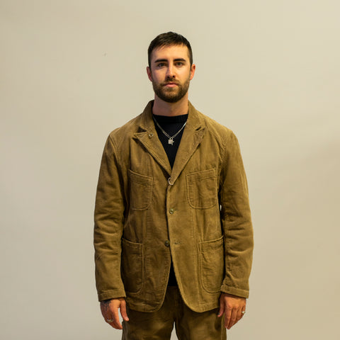 Model wearing Engineered Garments Bedford Jacket khaki
