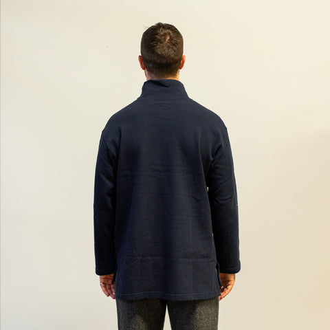 Male model wearing Engineered Garments Mock Turtle Dark Navy