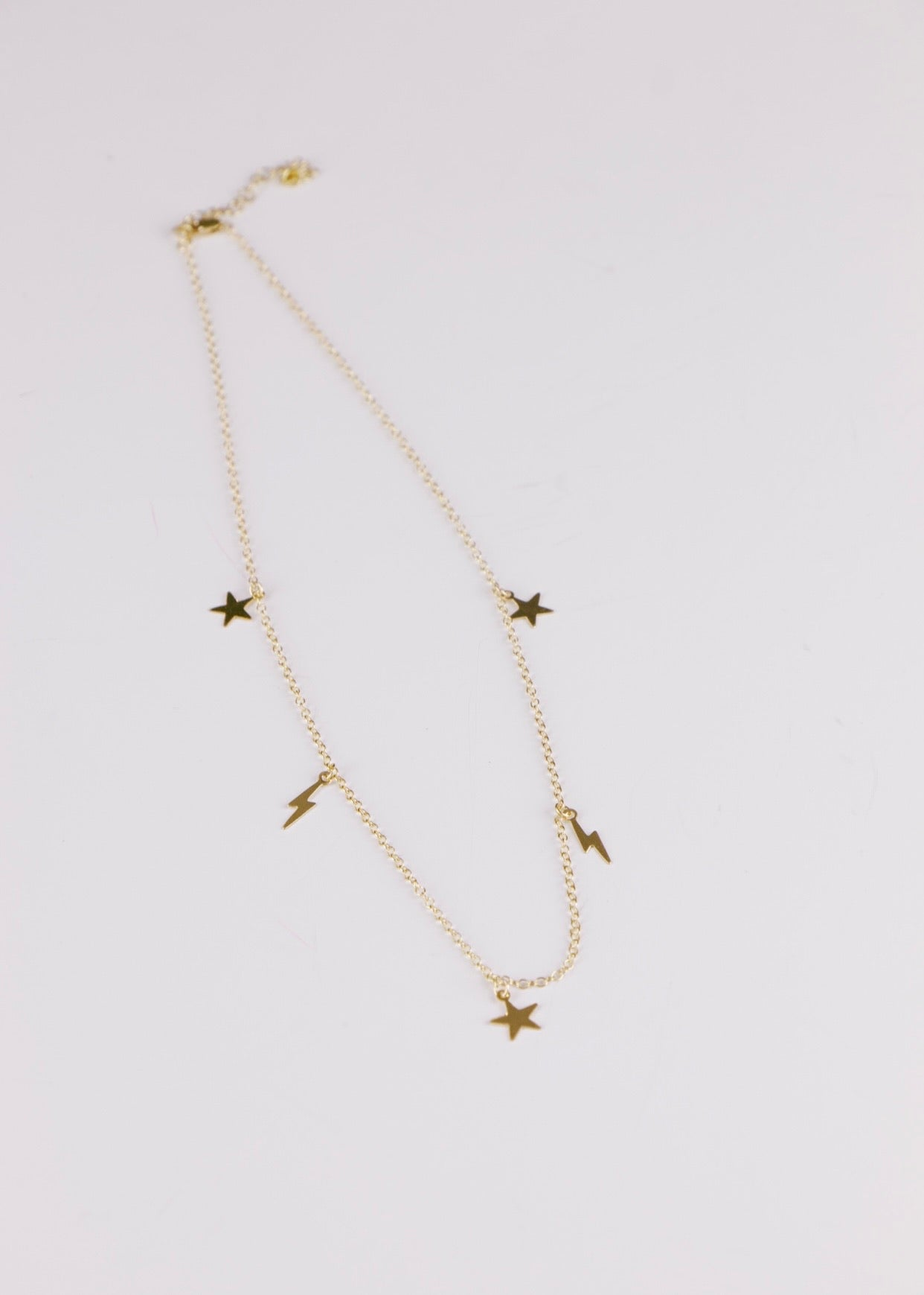 GOLD LIGHTING BOLTS & STARS NECKLACE