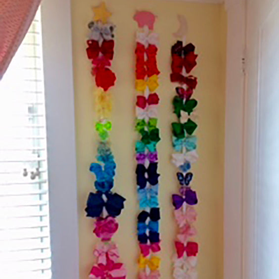 Wee One's bows hanging on the wall