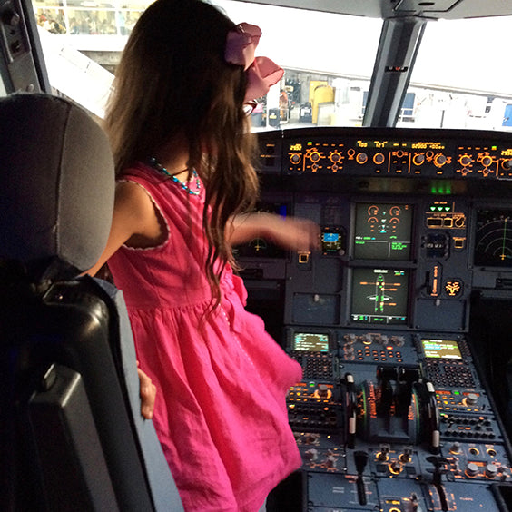 Classic Girl Clothing pink linen dress on girl in a plane