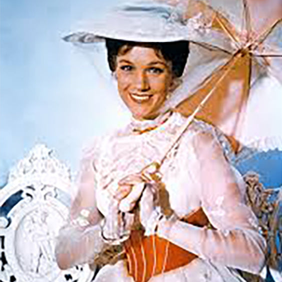 Mary Poppins dresses elegantly in white with a parasol
