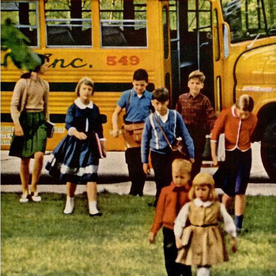 1960's yellow school buss with kids exiting