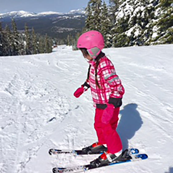 Founder of Classic Girl's daughter in pink ski outfit