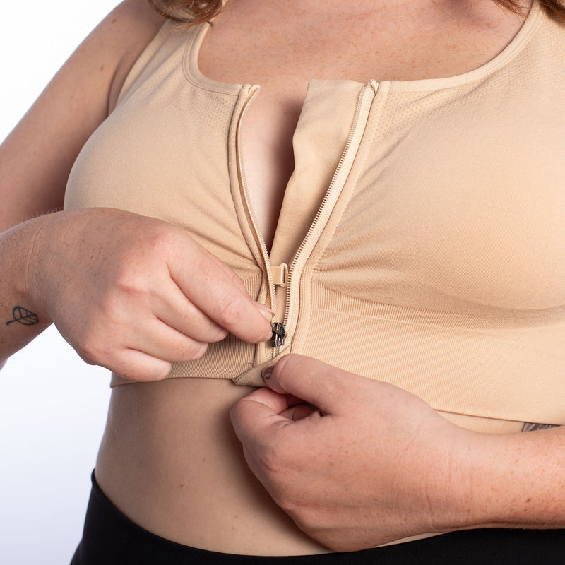 Front Lock Zipper and G-hook for easy zipping of the HuggerVIDA shown in Wheat Beige. Medium to Low compression. Everyday, wire-free bra for comfort and support. Made especially for those want lower compression that still shapes & supports for really comfortable wear; women who prefer to sleep in a bra; those transitioning from a higher compression garment post-surgically; women needing a comfortable go-to bra for the demands of daily life. Daily bra. Sleep bra. Comfy bra. Easy bra sizes. Go to bra.