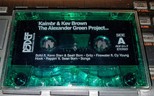 "Kaimbr & Kev Brown ""THE ALEXANDER GREEN PROJECT""  GREEN CLEAR CASSETTE TAPE AND KEV BROWN BUTTON"
