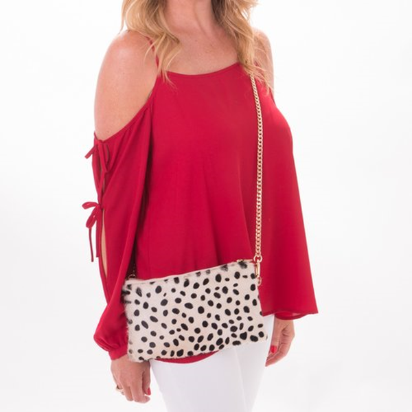 The Dalmation Cowhide Crossbody Clutch