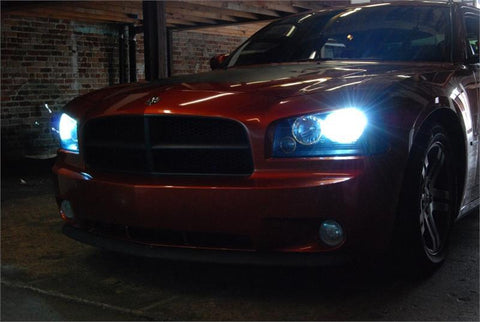 Dodge vehicle parked in the dark with the lights on