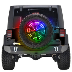 A spare tire with rainbow lights on the back of a Jeep