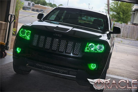 A black Jeep with green halo headlights