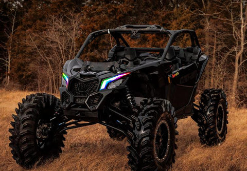 atv with multicolored headlights in a forest